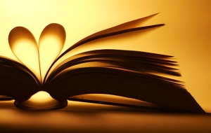 An open book with a page bent in a heart-shape